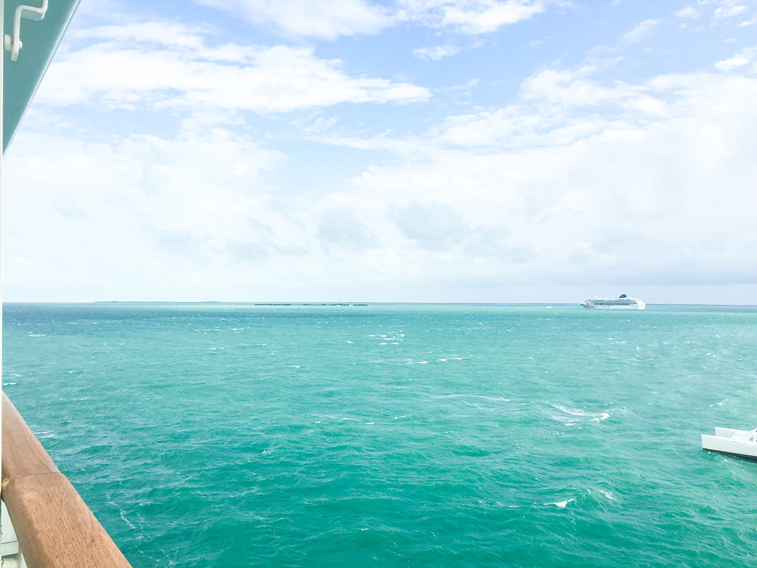 Stormy turquoise waters and small island from afar in Belize