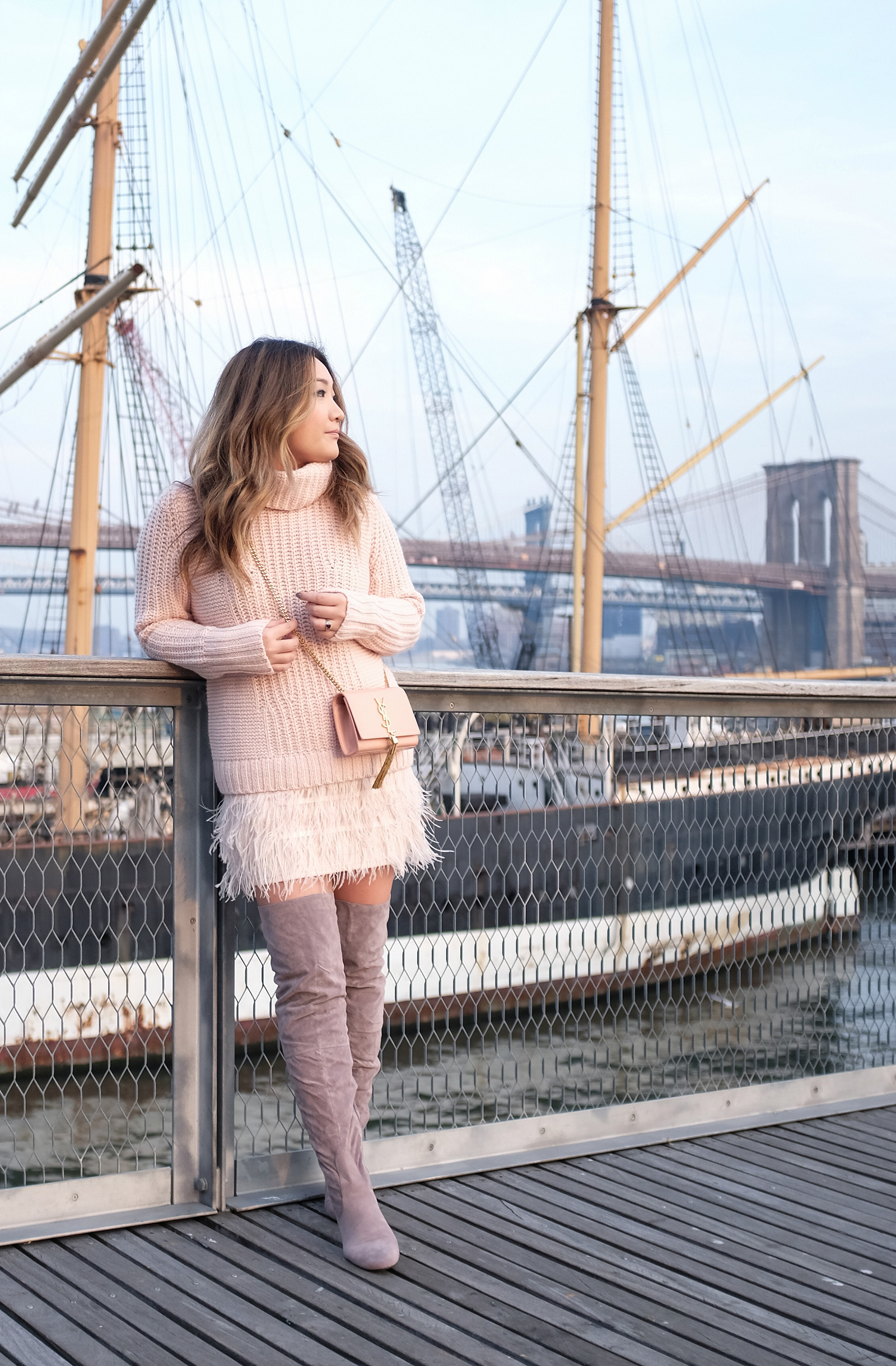 grey otk boots, feather skirt, soft pink sweater