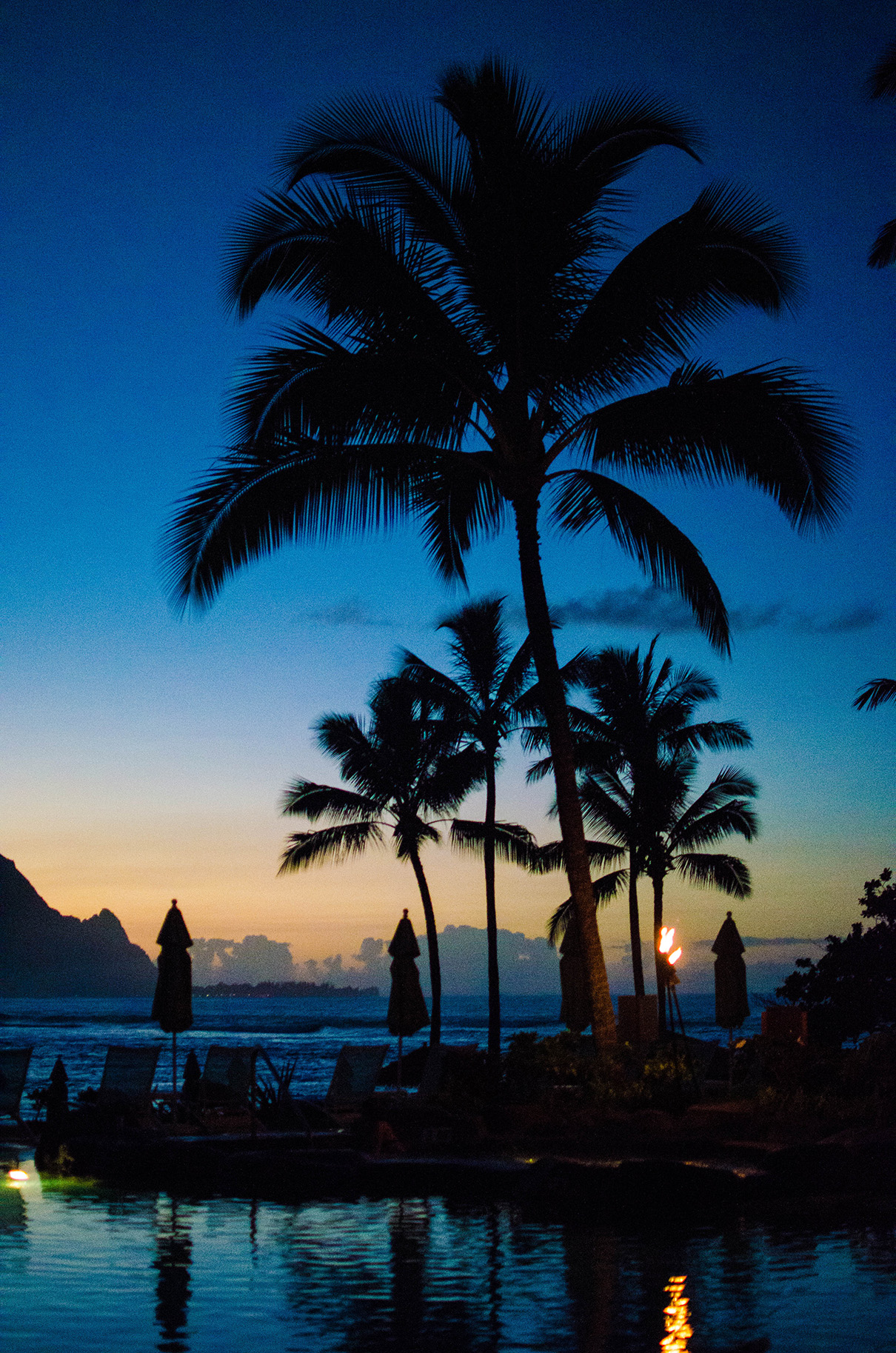Sunset by the pool at The St. Regis Kauai