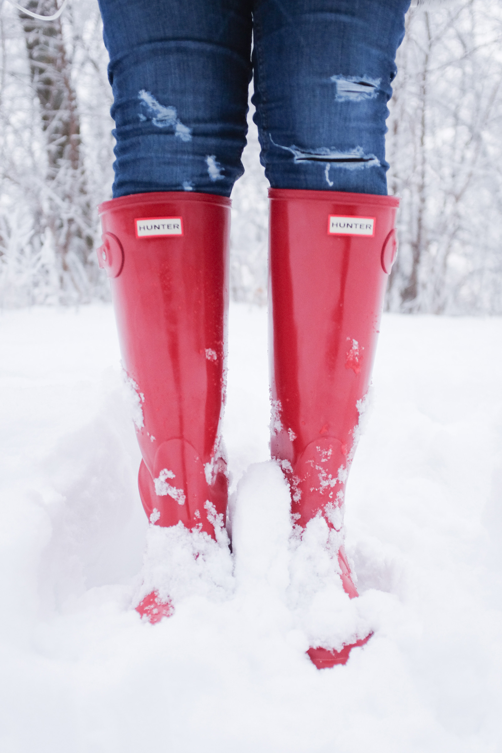 red hunter boots in snow