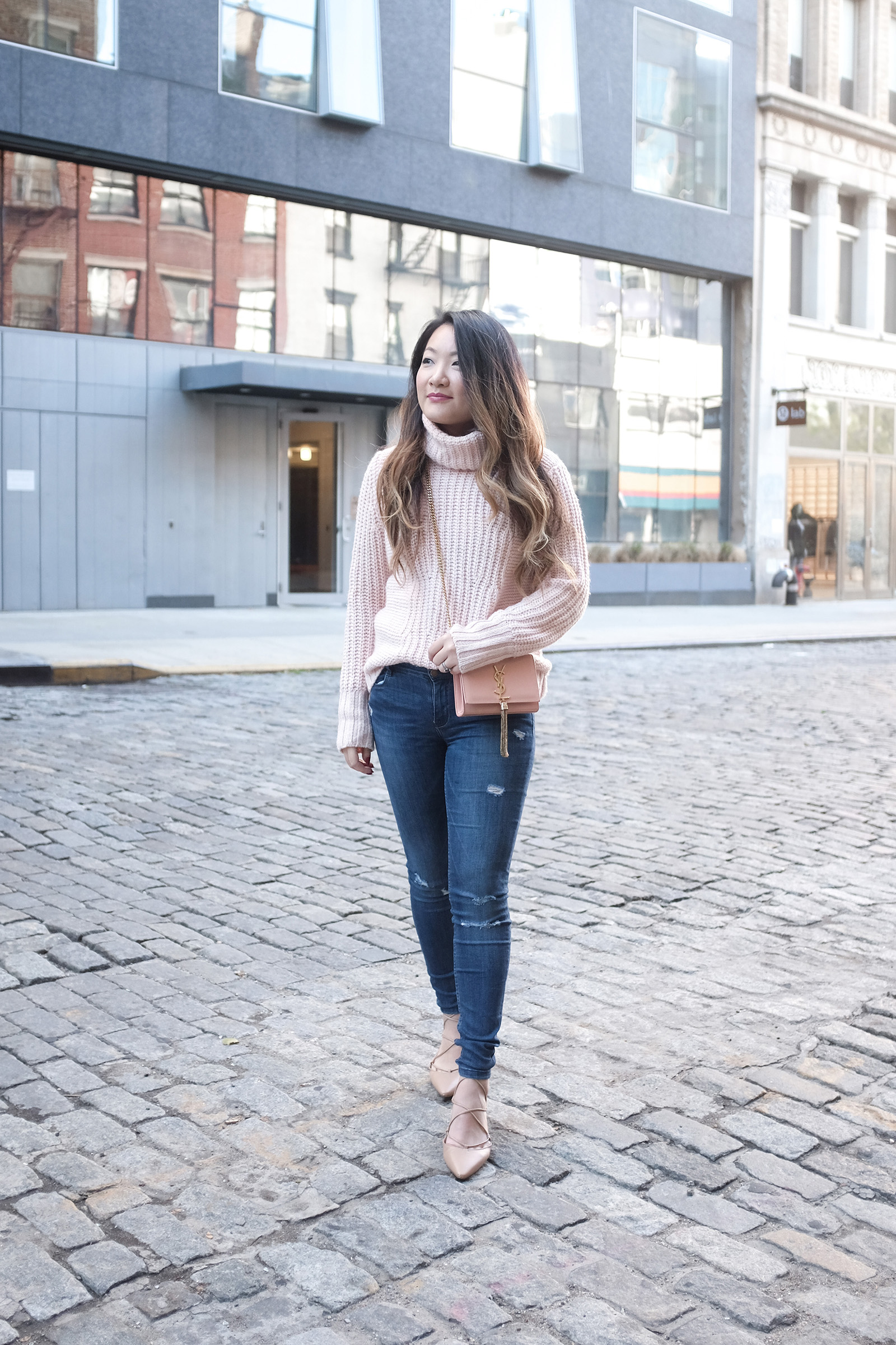 Blush chunky sweater, blue skinny jeans